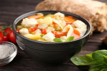 Homemade turkey soup in bowl on table
