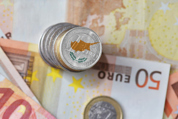 euro coin with national flag of cyprus on the euro money banknotes background.