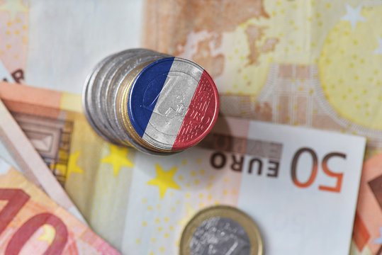 euro coin with national flag of france on the euro money banknotes background.