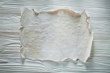 Vintage paper sheet on wooden board