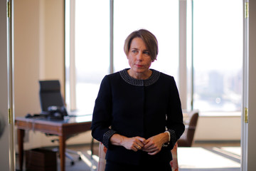 Massachusetts Attorney General Maura Healey listens to a question during an interview with Reuters at her office in Boston
