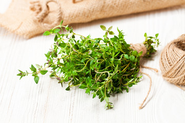 Fresh  bunch of thyme on white table