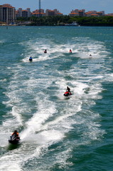 Jet skiers racing through the florida intra-coastal off Miami Beach on a Saturday afternoon.