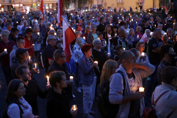 People attend a protest against judicial reforms in front of the Supreme Court in Warsaw