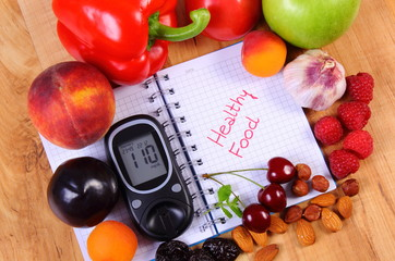 Fresh fruits and vegetables with glucose meter and notebook for notes