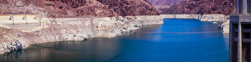 Blue Lake Mead water and Grand Canyon cliffs