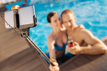 Young couple taking a picture with selfie stick