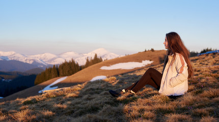 Shot of a woman admiring stunning view sitting on top of a mountain copyspace peace nature harmony lifestyle active sportive healthy relaxing resting meditative