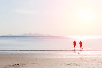 friends walking in the sea beach, lonely summer season vintage color tone.