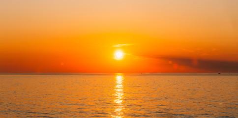 Autocollant pour porte Orange eclat Sun Is Setting On Horizon At Sunset Sunrise Over Sea Or Ocean.