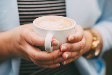 Female hands with a cup of coffee