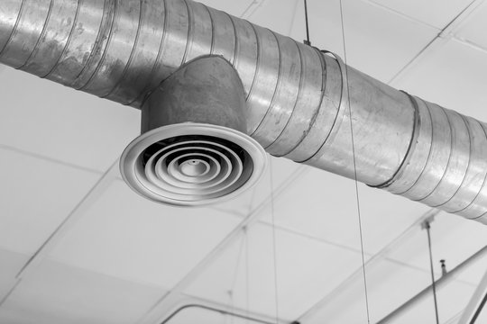 Air Duct or Air Conditioners Pipe, Danger and the cause of pneumonia in office man.