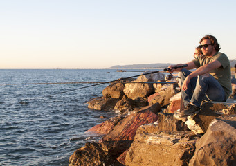 Fishermen at sunset in Mediterranean Sea