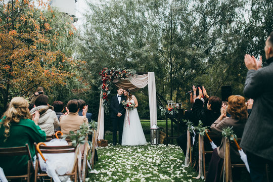 Beautiful wedding couple on the wedding autumn ceremony
