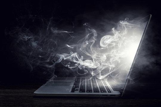 Laptop device damage. Mixed media