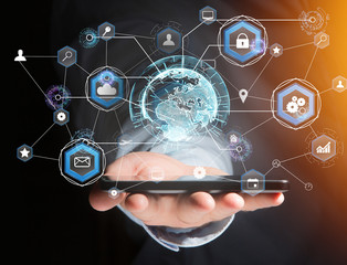 International business network connection displayed on a futuristic interface with technology icon and sphere globe - Worldwide business concept