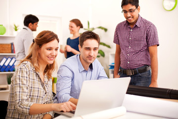 Young business people enjoying working  in the office