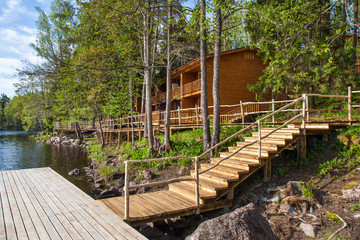 Wooden paths near the lake in the spring forest of Karelia