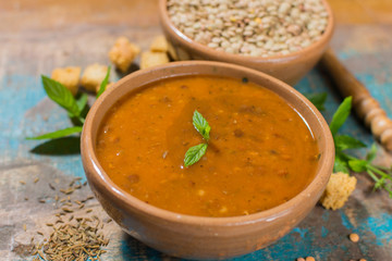 Homemade red lentils soup in yellow bowl
