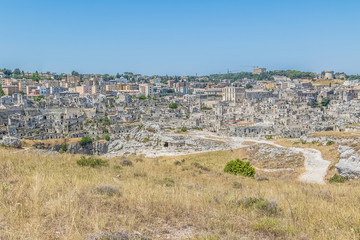 panoramic view of typical stones (Sassi di Matera) of Matera UNESCO European Capital of Culture 2019 under blue sky. Basilicata