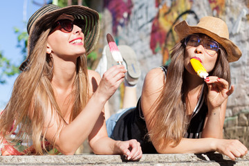 two young women eating an ice cream