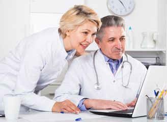 Doctor and nurse reading information