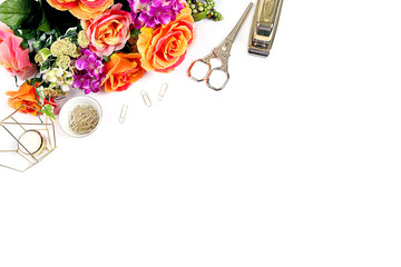 Styled desktop with whte bckground, flowers, gold stapler, gold accessories