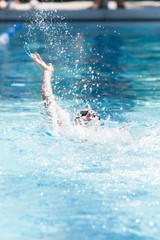 Young Female Swimming Backstroke