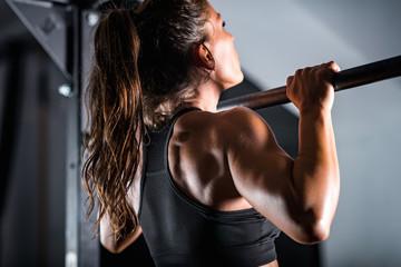 Woman athlete doing pull ups