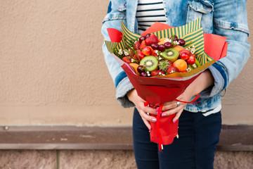 woman holding fruit bouquet