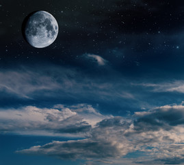 Half moon with stars and nebulae.