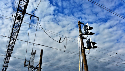 High voltage electric industrial gear on a background of blue cloudy sky