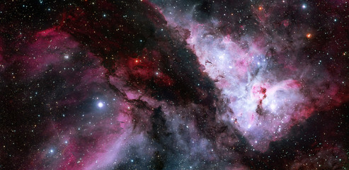 The Carina Nebula with an earlier picture of the Eta Carinae. Elements of this Image Furnished by NASA