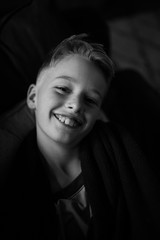 Portrait of young boy smiling, black and white