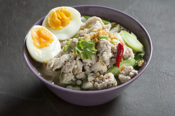 Spicy Tom Yam Wide Rice noodles soup with Vegetables and meats.