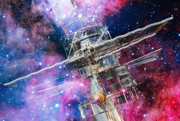 Hubble Space Telescope and nebula. Double exposure. Elements of this Image Furnished by NASA