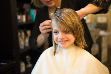 Girl having haircut