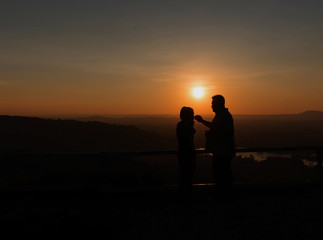 Silhouette sweethearts romantic young couple in love.