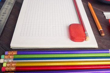 school notepad with colorful pencils