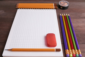 school exercise book with colorful pencils