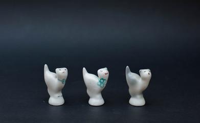 Porcelain kittens on black background