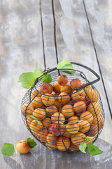 old iron vintage basket with apricots on a wooden background
