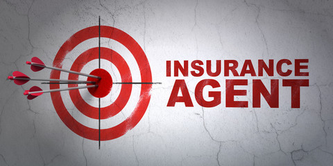 Insurance concept: target and Insurance Agent on wall background