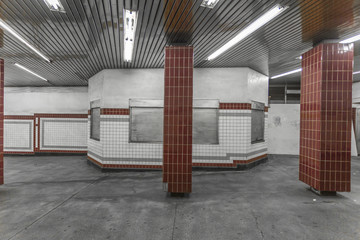 Tile in a subway station with a closed booth