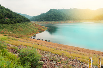 Tourist boat at Khun dan parker chol dam parking in the evening.