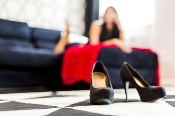 Closeup of high heels shoes in a hotel room