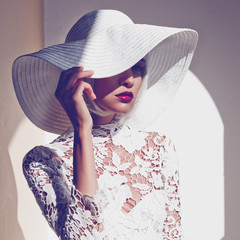 Beautiful lady in hat and sunglasses
