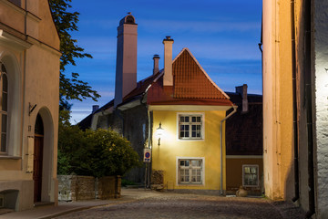 small historical house in Tallinn's old town. Beautiful night view of the medieval building and the sky. Architectural landmark of Estonia. The summer season.
