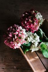 Hydrangea flowers in a vintage wooden box.
