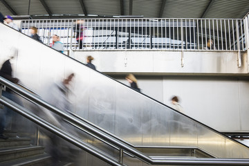 People rushing stairs and escalator